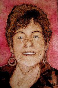 Een afbeelding van een vrouw, gemaakt met de techniek van het brandschilderen als herinnering in glas | door glasatelier ruud harberts